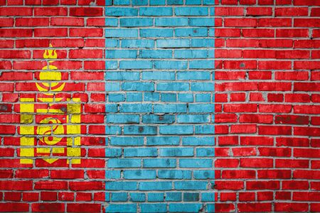 National flag of Mongolia depicting in paint colors on an old brick wall. Flag  banner on brick wall background. 版權商用圖片