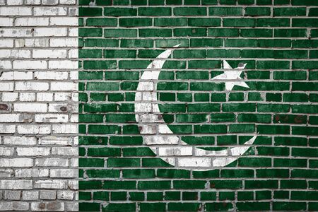 National flag of Pakistan depicting in paint colors on an old brick wall. Flag  banner on brick wall background.
