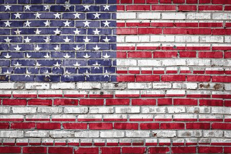 National flag of USA depicting in paint colors on an old brick wall. Flag  banner on brick wall background. 版權商用圖片
