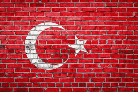 National flag of Turkey  depicting in paint colors on an old brick wall. Flag  banner on brick wall background. 版權商用圖片