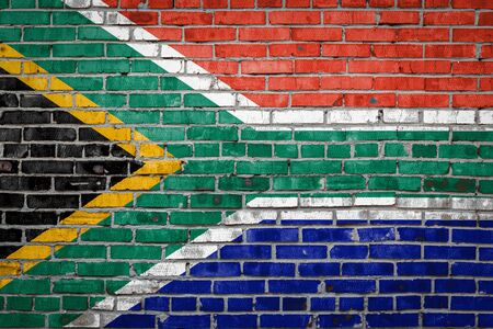 National flag of South African Republic depicting in paint colors on an old brick wall. Flag  banner on brick wall background. 版權商用圖片