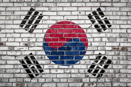 National flag of South Korea  depicting in paint colors on an old brick wall. Flag  banner on brick wall background. 版權商用圖片