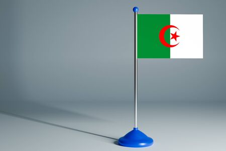 The 3d rendering  realistic national flag of Algeria on steel pole on gray isolated background.  Blank table flag , suitable for design, mockup