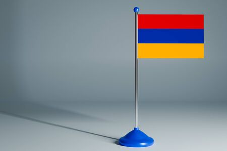 The 3d rendering  realistic national flag of Armenia on steel pole on gray isolated background.  Blank table flag , suitable for design, mockup