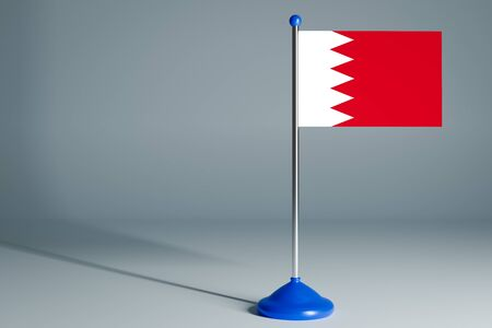 The 3d rendering  realistic national flag of Bahrain on steel pole on gray isolated background.  Blank table flag , suitable for design, mockup