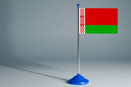 The 3d rendering  realistic national flag of Belarus on steel pole on gray isolated background.  Blank table flag , suitable for design, mockup
