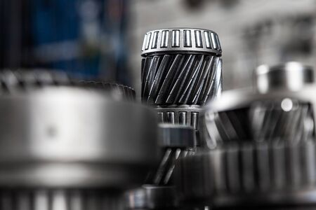 Close-up of a car gearbox. Metallic shiny gears for planetary gearshift. Industrial metal gears for Background Reklamní fotografie