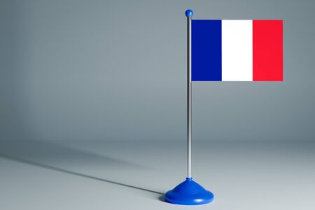The 3d rendering  realistic national flag of France on steel pole on gray isolated background.  Blank table flag , suitable for design, mockup Banco de Imagens