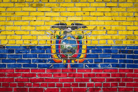 National flag of Ecuador  depicting in paint colors on an old brick wall. Flag  banner on brick wall background.