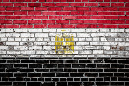 National flag of Egypt  depicting in paint colors on an old brick wall. Flag  banner on brick wall background.