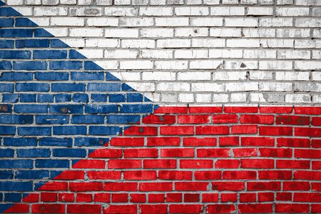 National flag of Czech depicting in paint colors on an old brick wall. Flag  banner on brick wall background.