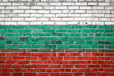 National flag of Bulgaria  depicting in paint colors on an old brick wall. Flag  banner on brick wall background. Stock Photo