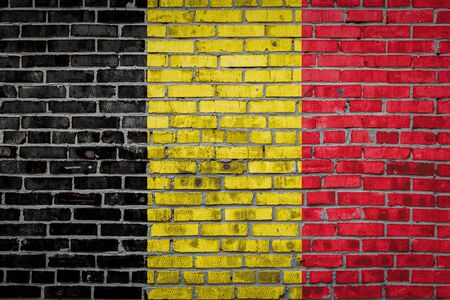 National flag of Belgium  depicting in paint colors on an old brick wall. Flag  banner on brick wall background.