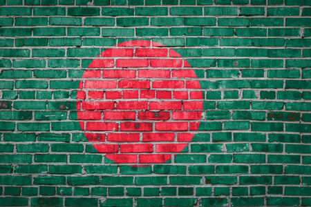 National flag of Bangladesh  depicting in paint colors on an old brick wall. Flag  banner on brick wall background. Stock Photo