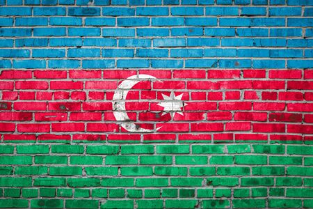 National flag of Azerbaijan  depicting in paint colors on an old brick wall. Flag  banner on brick wall background.