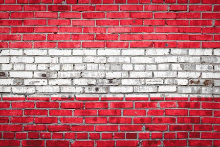 National flag of Austria depicting in paint colors on an old brick wall. Flag  banner on brick wall background.