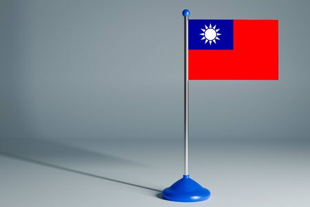 The 3d rendering  realistic national flag of Taiwan on steel pole on gray isolated background.  Blank table flag , suitable for design, mockup