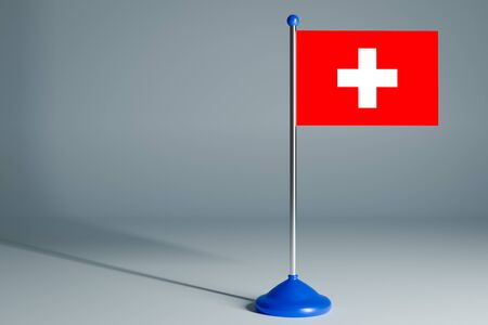 The 3d rendering  realistic national flag of Switzerland on steel pole on gray isolated background.  Blank table flag , suitable for design, mockup