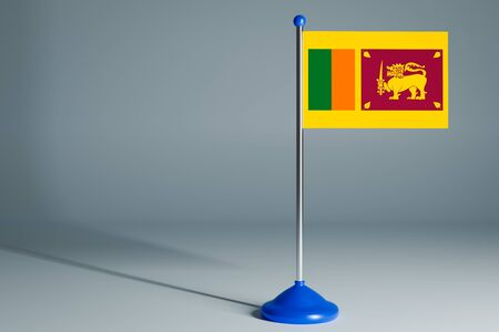 The 3d rendering  realistic national flag of Sri Lanka on steel pole on gray isolated background.  Blank table flag , suitable for design, mockup Stock Photo