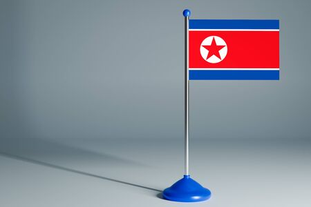 The 3d rendering  realistic national flag of North Korea on steel pole on gray isolated background.  Blank table flag , suitable for design, mockup