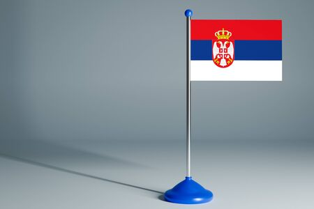 The 3d rendering  realistic national flag of Serbia on steel pole on gray isolated background.  Blank table flag , suitable for design, mockup Stock Photo