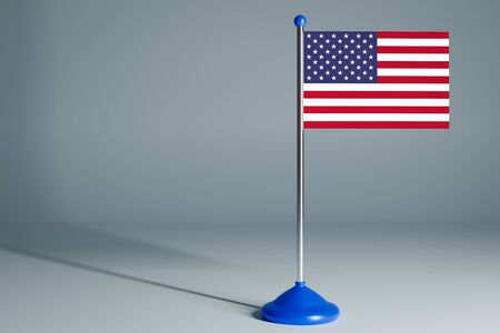The 3d rendering  realistic national flag of USA on steel pole on gray isolated background.  Blank table flag , suitable for design, mockup Stock Photo