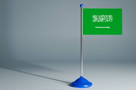 The 3d rendering  realistic national flag of Saudi Arabia on steel pole on gray isolated background.  Blank table flag , suitable for design, mockup