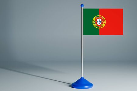 The 3d rendering  realistic national flag of Portugal on steel pole on gray isolated background.  Blank table flag , suitable for design, mockup