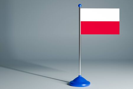 The 3d rendering  realistic national flag of Poland on steel pole on gray isolated background.  Blank table flag , suitable for design, mockup