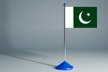 The 3d rendering  realistic national flag of Pakistan on steel pole on gray isolated background.  Blank table flag , suitable for design, mockup