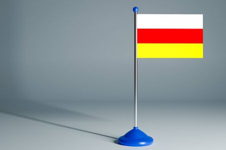The 3d rendering  realistic national flag of Ossetia on steel pole on gray isolated background.  Blank table flag , suitable for design, mockup