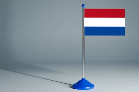 The 3d rendering  realistic national flag of Netherlands on steel pole on gray isolated background.  Blank table flag , suitable for design, mockup
