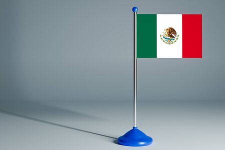 The 3d rendering  realistic national flag of Mexico on steel pole on gray isolated background.  Blank table flag , suitable for design, mockup