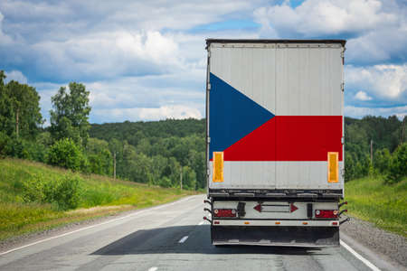 A  truck with the national flag of Czech