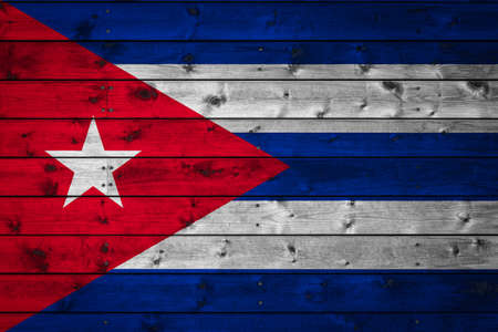 The national flag of Cuba is painted on a camp of even boards nailed with a nail. The symbol of the country. Фото со стока