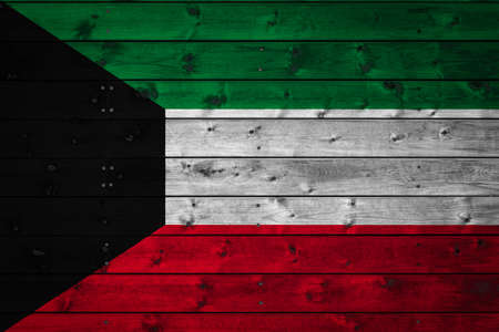 The national flag of Kuwait is painted on a camp of even boards nailed with a nail. The symbol of the country. Фото со стока
