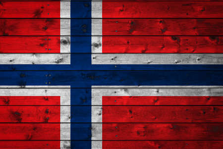 The national flag of Norway is painted on a camp of even boards nailed with a nail. The symbol of the country.