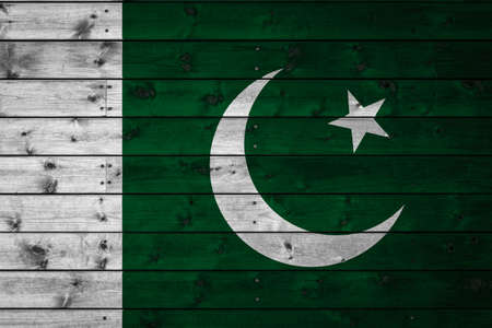 The national flag of Pakistan is painted on a camp of even boards nailed with a nail. The symbol of the country.