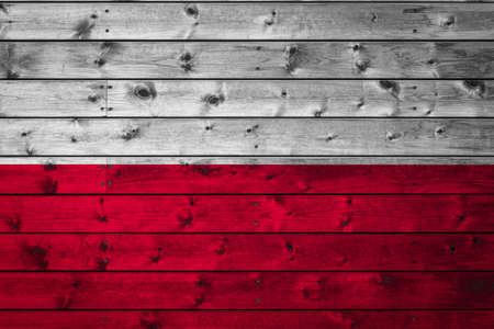 The national flag of Poland is painted on a camp of even boards nailed with a nail. The symbol of the country. Foto de archivo
