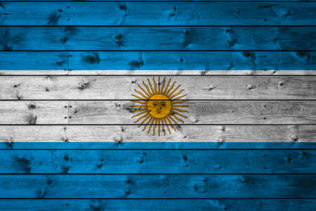 The national flag of Argentina is painted on a camp of even boards nailed with a nail. The symbol of the country. Фото со стока