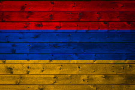 The national flag of Armenia is painted on a camp of even boards nailed with a nail. The symbol of the country. Foto de archivo