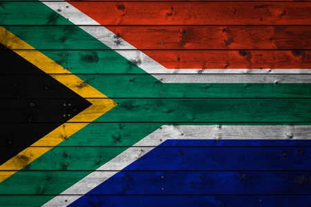 The national flag of South African Republic is painted on a camp of even boards nailed with a nail. The symbol of the country.