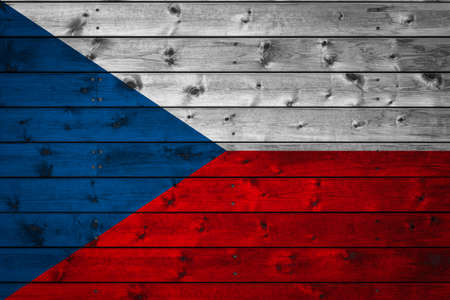 The national flag of Czech is painted on a camp of even boards nailed with a nail. The symbol of the country.