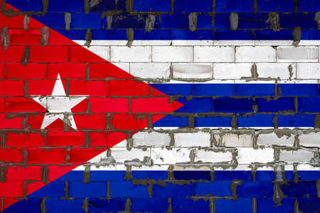 The national flag of Cuba painted on a wall of sibit blocks with cement. The symbol of the country.