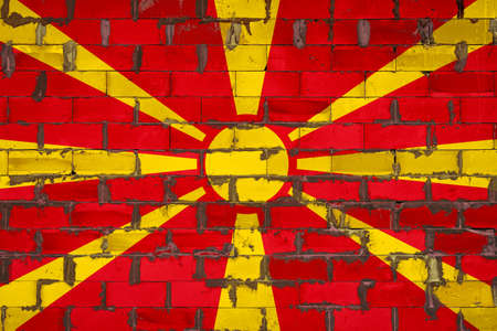 The national flag of Macedonia painted on a wall of sibit blocks with cement. The symbol of the country. 스톡 콘텐츠