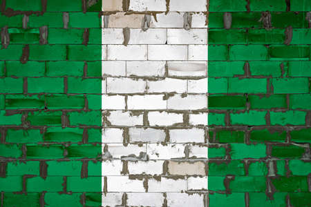 The national flag of Nigeria painted on a wall of sibit blocks with cement. The symbol of the country.