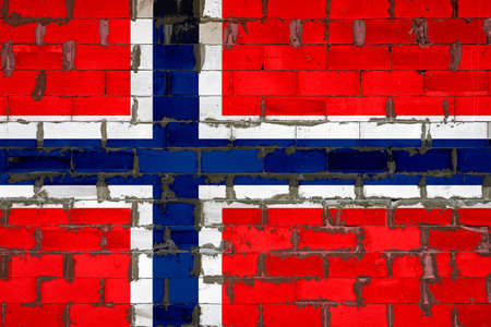 The national flag of Norway painted on a wall of sibit blocks with cement. The symbol of the country. 스톡 콘텐츠