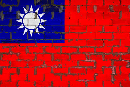 The national flag of Taiwan painted on a wall of sibit blocks with cement. The symbol of the country.