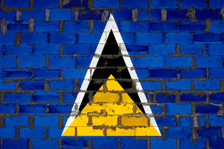 The national flag of Saint Lucia painted on a wall of sibit blocks with cement. The symbol of the country.