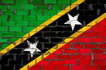 The national flag of Saint Kitts and Nevis painted on a wall of sibit blocks with cement. The symbol of the country.